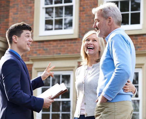 Realtor Showing Mature Couple Around House For Sale; Shutterstock ID 518371450; PO: Sam; Job: Refresh; Client: Trulia