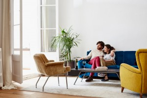 Couple-Sitting-On-Couch-031616